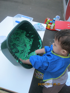 Busy Bees, Child playing with paint at Early Learners' Nursery School, Leicester