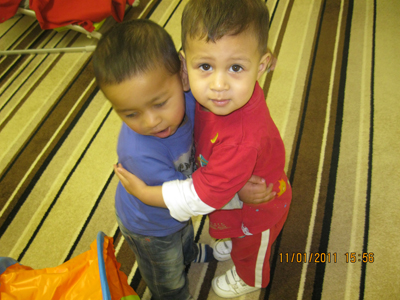 Children Hugging in the Busy Bees room, at Early Learners' Nursery School, Leicester