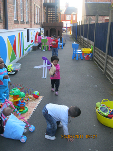 Pre-school children playing outside at Early Learners' Nursery School, Leicester