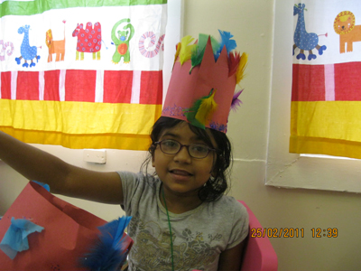 Pre-school aged girl with a handmade crown at Early Learners' Nursery School, Leicester